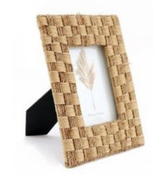 A charming way to display your photographed memories within your home, a natural rattan woven framed picture display