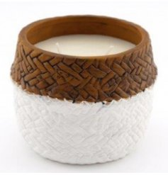 A two toned candle pot set with a woven inspired look and sweetly scented wax centre