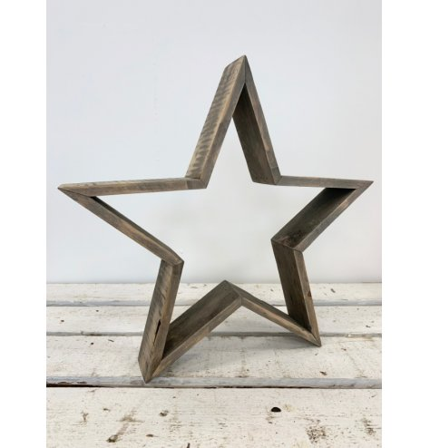 A Large Wooden Rustic Standing Star
