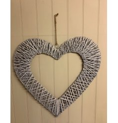 Sure to bring a sweetheart feature to any home space, a large sized hanging heart frame wrapped in a grey toned wicker