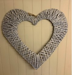 Sure to bring a sweetheart feature to any home space, an extra large sized hanging heart frame wrapped in a grey toned w