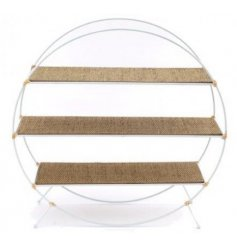 A large round multi level shelving unit with natural wood accents and charming simple finish