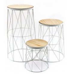 With their geometric decals and natural wood tops, these tables are sure to add a trendy touch to any home space