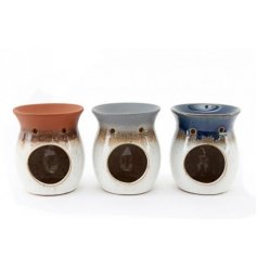 An assortment of smooth ceramic oil burners in a variation of reactive glazed tones