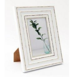 A wooden looking picture frame set with a distressed painted finish and antique look