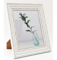 A large antique inspired picture frame with an overly distressed painted finish and large 10x8in picture space