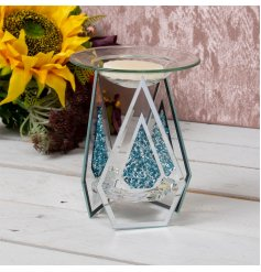 A strikingly beautiful tlight holder set with 3 glass panes each decorated with a blue crystal decal