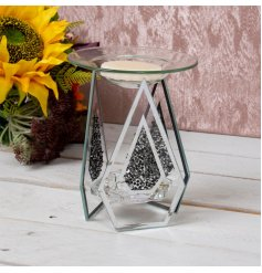 A strikingly beautiful tlight holder set with 3 glass panes each decorated with a black crystal decal