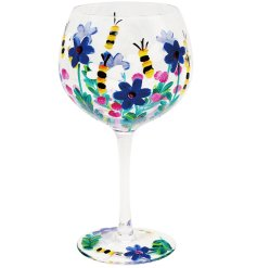 A colourful themed large Gin Glass featuring a painted Bees and Flowers decal in bold colours