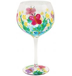 A large Gin Glass featuring a gorgeous painted Butterfly decal with bold colours and added floral themes
