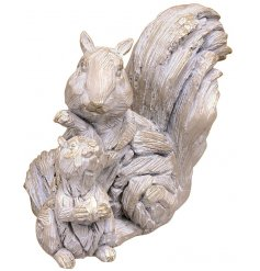An ornamental pair of Squirrel and Baby figures made to look like a natural Driftwood