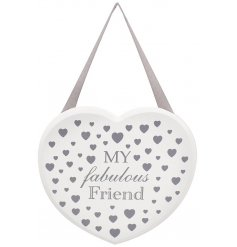 A hanging wooden heart plaque set with a silver toned scripted text decal and abundance of printed hearts