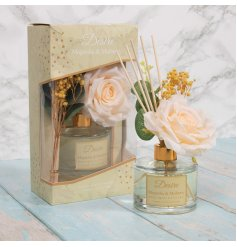 A gorgeously scented Reed Diffuser complete with added floral accents and a delightful gift box to match