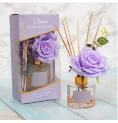 A delightfully scented Reed Diffuser featuring added floral decals and a pretty purple hint