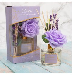 A Lavender & Camomile scented reed diffuser complete with added floral accents and a pretty purple tone