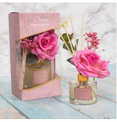 A delightfully scented Reed Diffuser featuring added floral decals and a pretty pink hint
