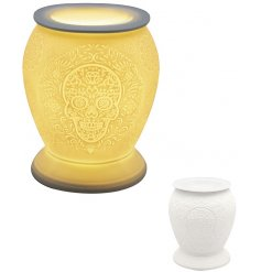 A beautifully detailed ceramic based aroma lamp featuring a sugar skull inspired embossed design and warm glowing LED C