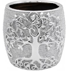 this decorative planter features a charming Tree of Life embossment and rough touch finish