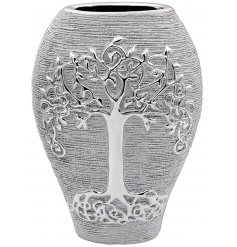 A luxury themed ceramic planter featuring a bold Tree of Life decal and rough silver coating to it