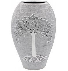 A gorgeously decorated tall shaped vase in a luxury silver tone
