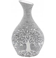 A gorgeously decorated shaped vase in a luxury silver tone