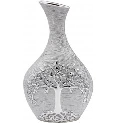 A gorgeously decorated silver toned vase with an embossed Tree of Life Decal