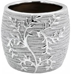 A charming little decorative planter featuring a a bold climbing leaf pattern and luxury silver tone