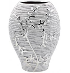 A gorgeously decorated shaped vase complete with a silver tone and climbing leaf pattern effect