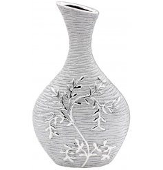 A shaped vase featuring a climbing leaf embossed decal and rough touch finish,