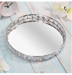 A sleek and stylish round mirrored tray, beautifully complete with a glitzy crystal edging