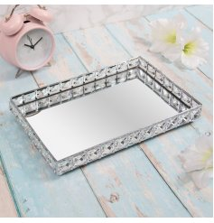 A large rectangular mirrored tray featuring a raised edging with added crystal features
