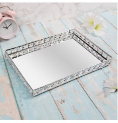 a large rectangular tray with crystal sides and a mirrored centre