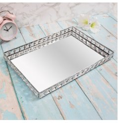 Bring a gorgeous glitzy hint to your home interior with this sleek rectangular shaped tray with added crystal accents an