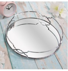a round shaped mirrored tray with a silver curved edging in a Gatsby theme