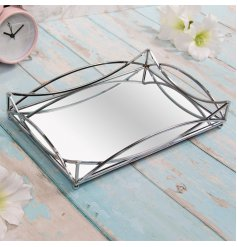 this rectangular mirrored tray features a Gatsby inspired silver edging also