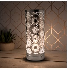 Covered with a beautiful Sparkle inspired cut decal, this Desire Touch Lamp is also set with a striking Silver Tone fini