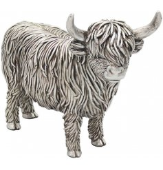 A standing ornamental Highland Cow in a Rustic Silver Tone