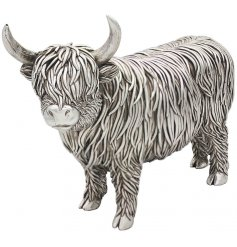 A charming little ornamental highland cow figure set with a rustic silver tone