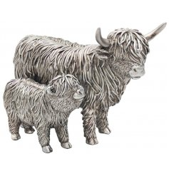 Sure to bring a Country Charm sense into any home space, a delightful little Resin Highland Cow and Calf Ornament in a r