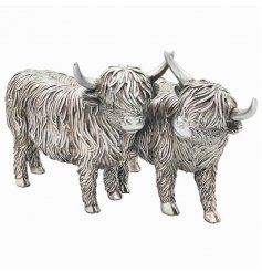 Sure to bring a Country Charm sense into any home space, a delightful duo of Resin Highland Cows in a rustic silver tone