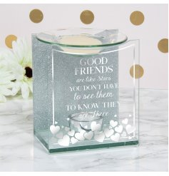 A gorgeously finished clear glass Oil Burner with a glittery backdrop, silver accents and bold scripted text decal