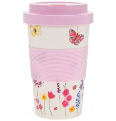 A beautifully decorated bamboo travel mug with a secure screw top cap and matching sleeve
