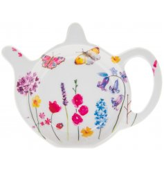this small teapot shaped teabag tidy is sure to add a spring charm to your kitchen