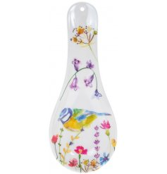 A charming spoon rest decorated with a floral decal and garden birds to finish