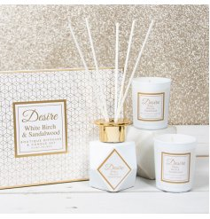 A gorgeously presented gift set filled with lusciously scented wax candles and a reed diffuser
