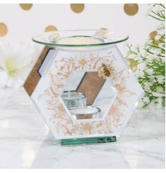 with its mirrored accents and glittery gold floral prints this tlight holder is sure to bring a hint of luxury to any s