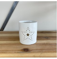 Decorated with a dotted Star decal, this small ceramic candle pot is sure to bring a cosy glow to any home space