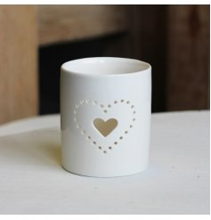Set with a dotted heart text decal, this simple themed ceramic candle holder is a must have for any home