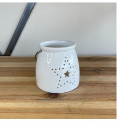 A small and simple ceramic T-light holder decorated with a dotted star motif