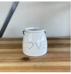 Perfect for adding a hint of coziness within in any home space, a small T-light holder with a dotted love text decal